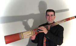 John Groves didgeridoo for school news